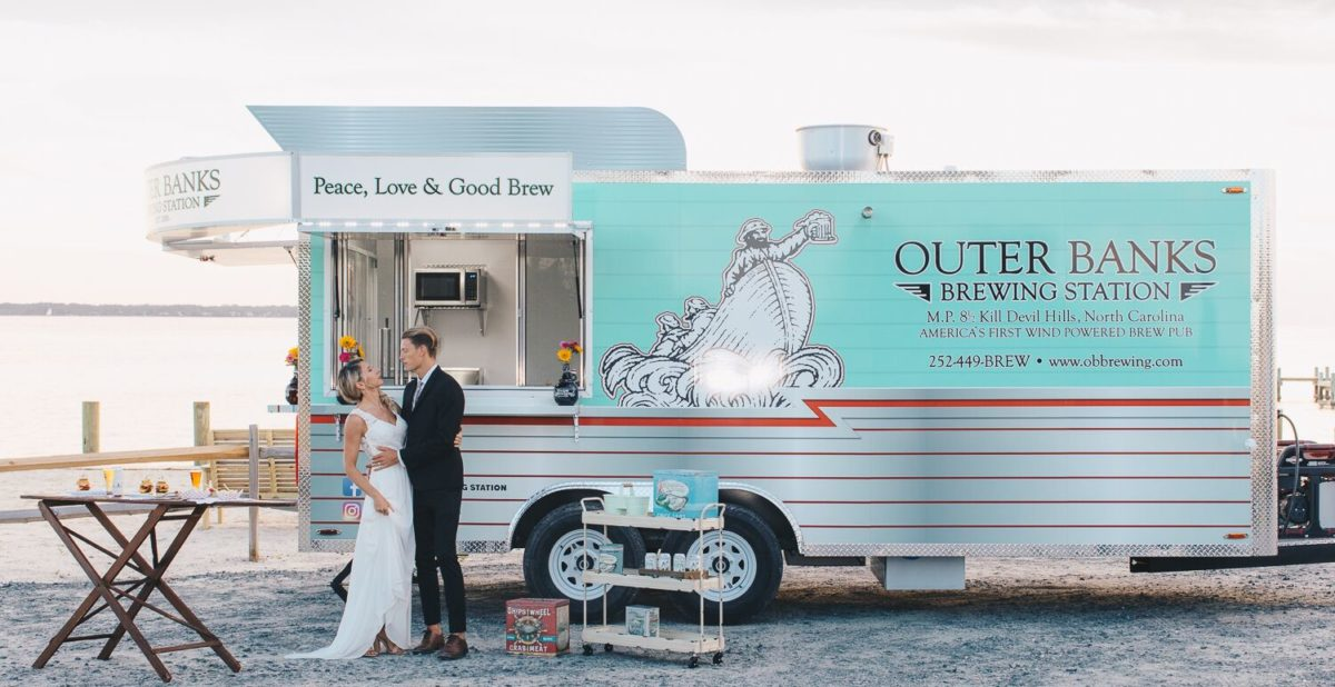 Bride and Groom staying by Outer Banks Brewing Station's catering truck