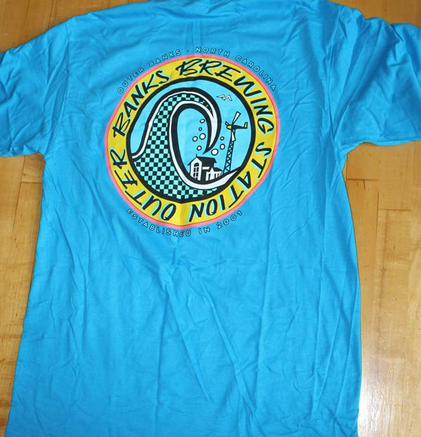 Baby blue Outer Banks t-shirt with a wave for the Outer Banks Brewing Station.